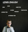 Thinking boy business man with learn English background