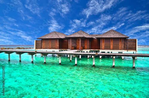 Wall Murals Green coral Beautiful water villa in Maldives