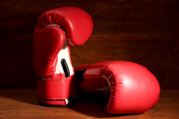 Boxing gloves on wooden background
