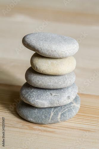 Deurstickers Stenen in het Zand Five spa zen stones stacked on a wood background