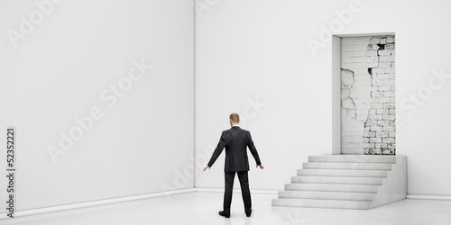 businessman into the room with blocked doorway Canvas Print