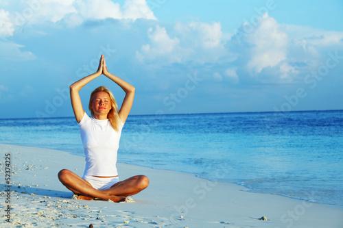 yoga woman on sea coast
