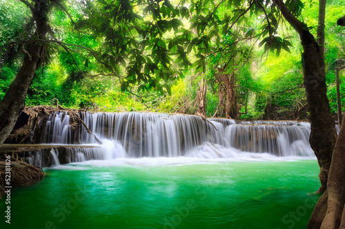 Photo Stands Green Thailand waterfall in Kanjanaburi