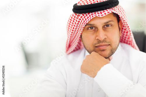 Tableau sur Toile handsome arabic businessman close up