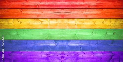 Fotomural Holzzaun mit Regenbogenfarben
