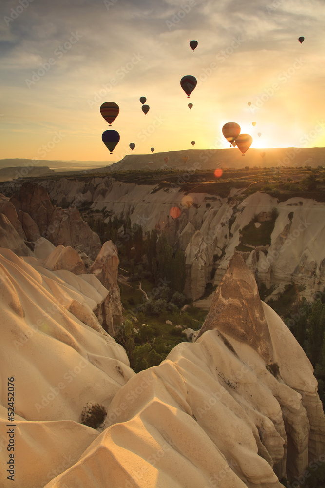 Fototapeta Hot air balloon over rock formations in Cappadocia, Turkey