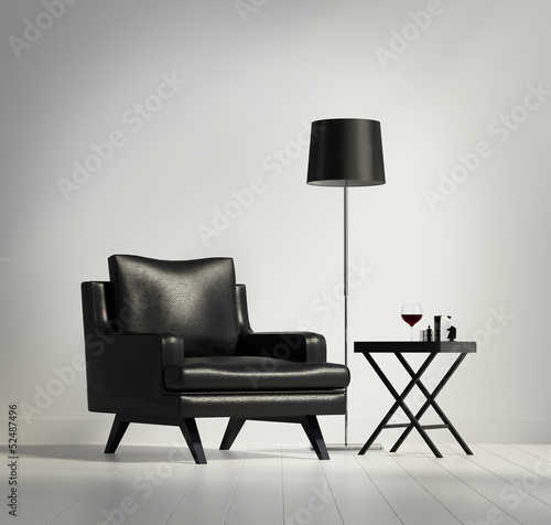 Luxury contemporary black leather armchair with stool and lamp Canvas Print