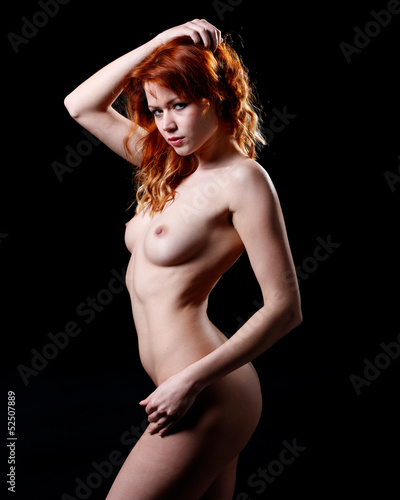 very beautiful nude or naked woman with red hair
