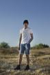 Male model posing in desert