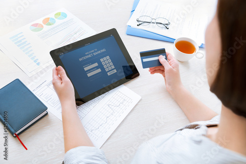 Fotografie, Obraz  Businesswoman using a credit card for online internet banking