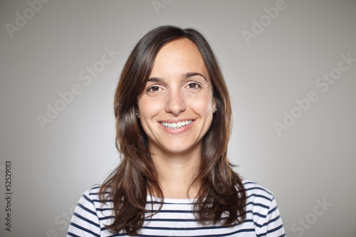 Obraz Portrait of a normal girl smiling - fototapety do salonu