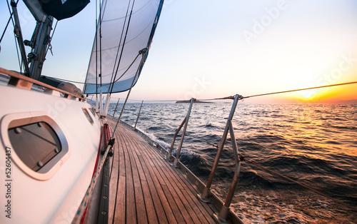 Sailing regatta in Greece, during sunset. Obraz na płótnie