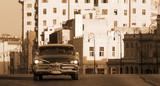 A classic car driving the Malecon, Havana, Cuba - 52610649