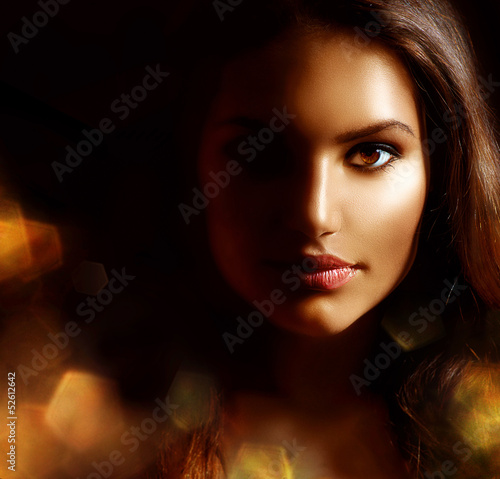 Fotografering  Beauty Girl Dark Portrait with Golden Sparks. Mysterious Woman