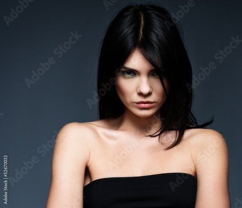 Young beautiful strict brunette woman Wallpaper Mural