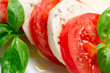 Caprese Salad. Tomato and Mozzarella slices with basil leaves