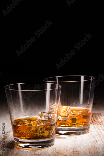 Foto op Canvas Alcohol two glasses of whiskey