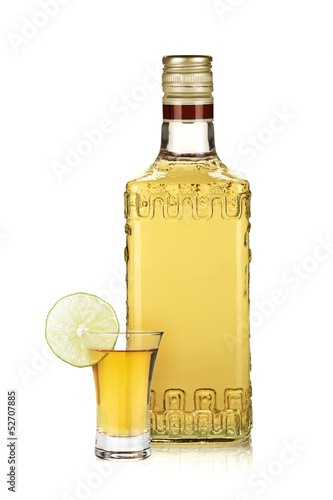 Fotografie, Obraz  Bottle of gold tequila and shot with lime slice
