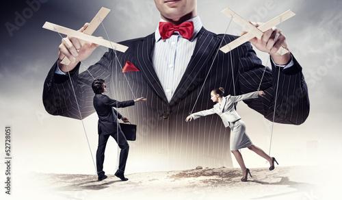 Fotografie, Obraz Businessman puppeteer