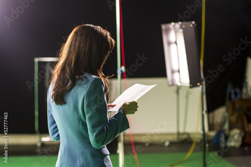 Photo  Actress Holding Script Rehearsing in Set