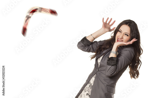 woman defending herself with her hands from the boomerang Canvas Print