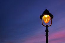 Lamppost Illuminated At Twilight