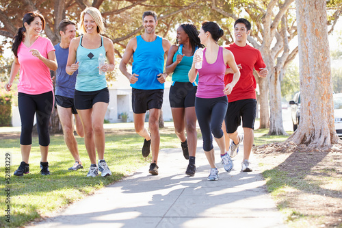 Foto  Group Of Runners On Suburban Street