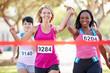 Leinwanddruck Bild - Two Female Runners Finishing Race Together