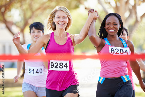Fotografie, Obraz  Two Female Runners Finishing Race Together