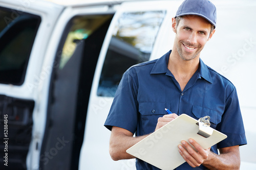 Fotografie, Obraz  Portrait Of Delivery Driver With Clipboard