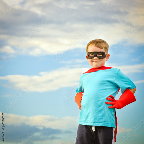 Child pretending to be a superhero with copy space Canvas Print