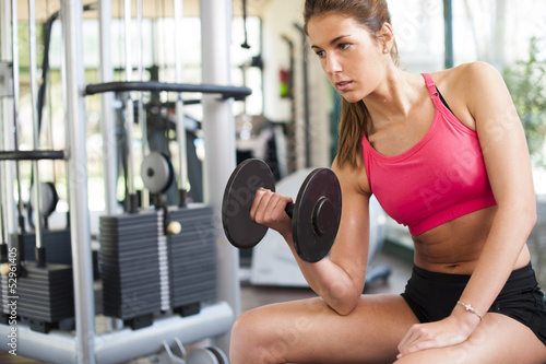 Spoed Foto op Canvas Fitness Girl working hard at gym
