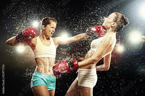 Two pretty women boxing