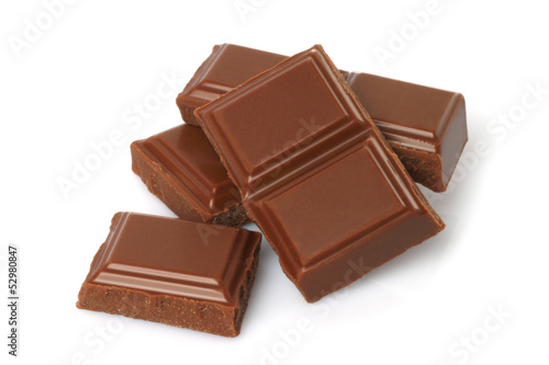 Fotografie, Obraz  Broken milk chocolate bar isolated on white background .