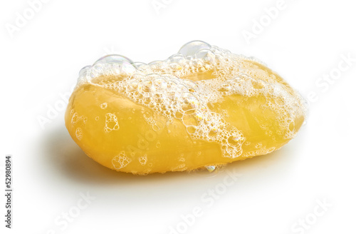Fotografie, Obraz  Yellow soap bubble of isolation on a white background