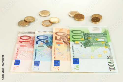 Fotobehang Planten Euro banknotes and euro cents isolated on white