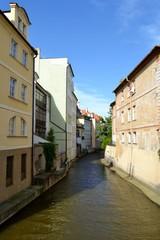 Fototapeta na wymiar Stream in Prague with houses