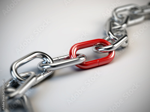 Fotografia  Chrome chain with a red link