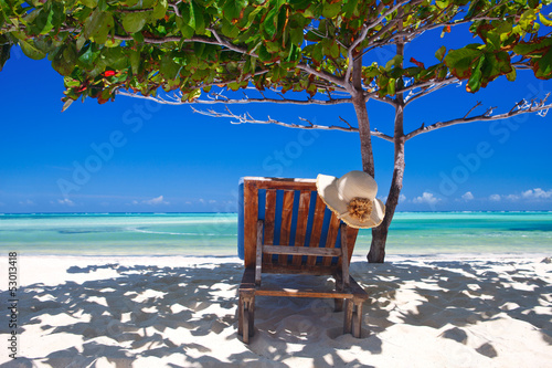 Poster Zanzibar Zanzibar tropical and beach chair at the beach