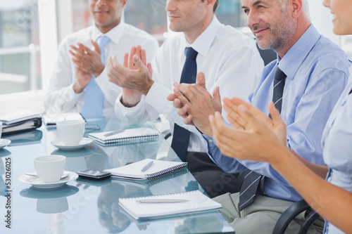 Fotografía  Group of business people clapping together