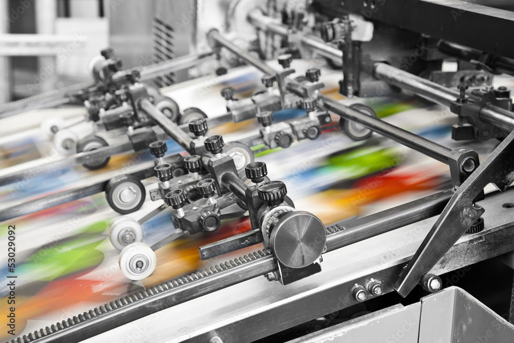 Fototapety, obrazy: Close up of an offset printing machine during production