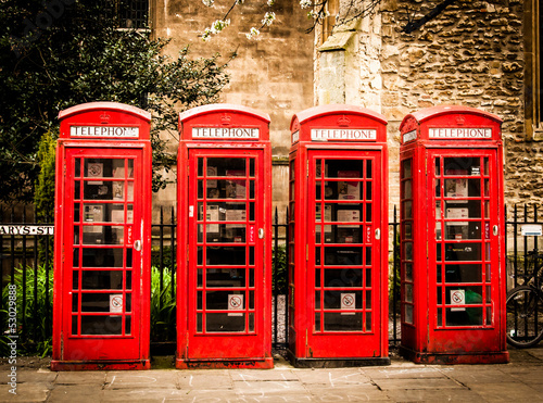Row od british red telephone boxes Poster