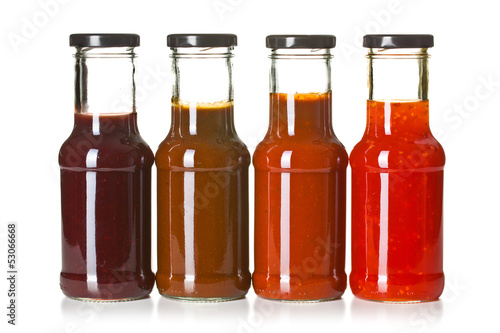 Fotografía  various barbecue sauces in glass bottles