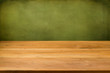 canvas print picture - Empty wooden table over grunge green background