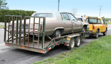 Cadillac On A Flatbed And Towe...