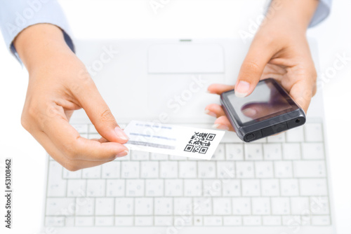 Fotografie, Obraz  Hands holding smart phone and business card with qr code