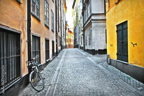 Photo Stands Narrow alley streets of old town . Stockholm