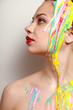 Beautiful woman painted with many vivid colors.