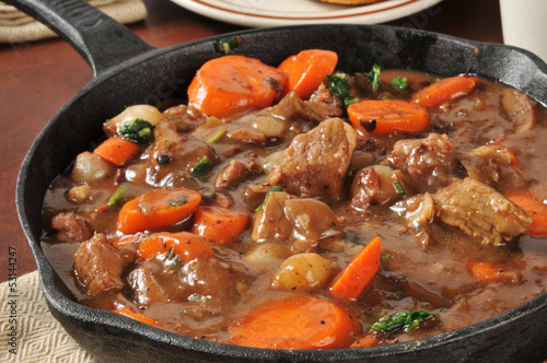 Fotografie, Obraz  Gourmet beef stew served in a cast iron skillet