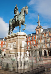 Madrid - Plaza Mayor in morning and statue of Philips III